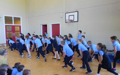 Third class perform for the school